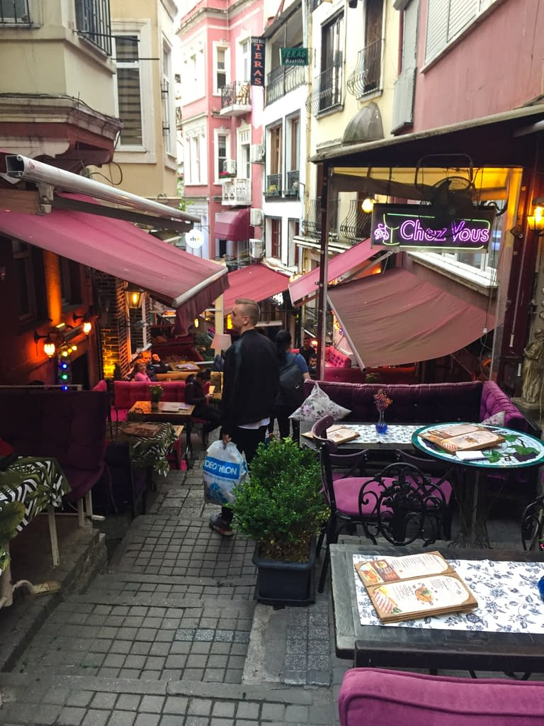 Colorful Cezayir Street with its purple sofas and tables.