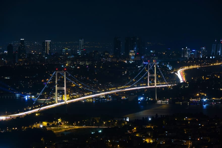 Bosphorus bridge and the silhouette of Leven business district at night