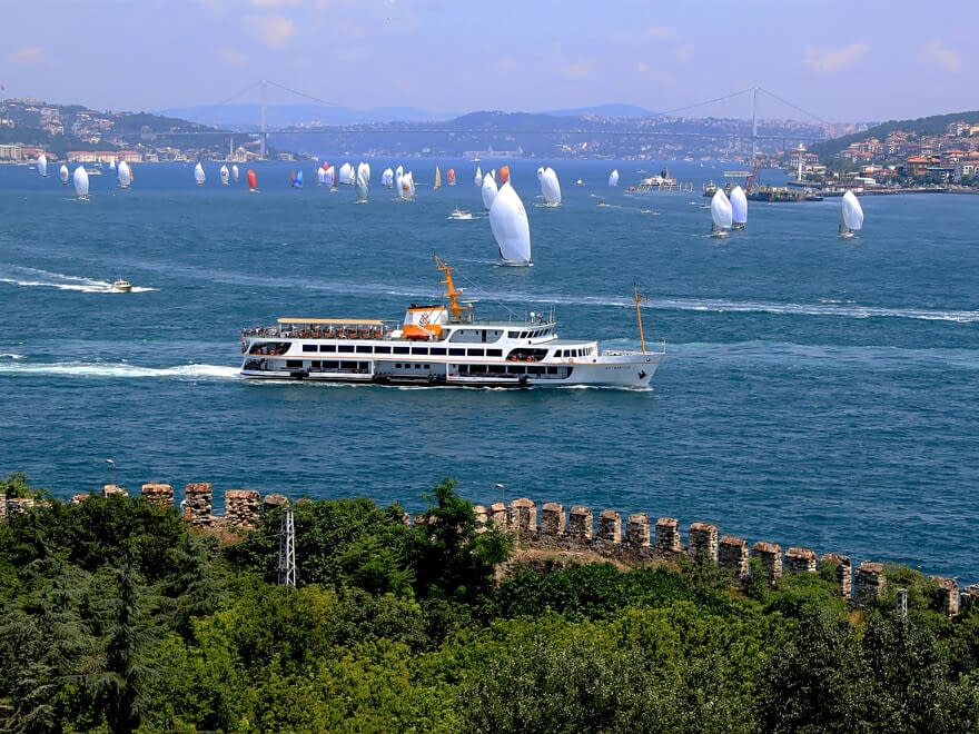 A ferry crossing the Bosphorus in Istanbul with sailboats in the background